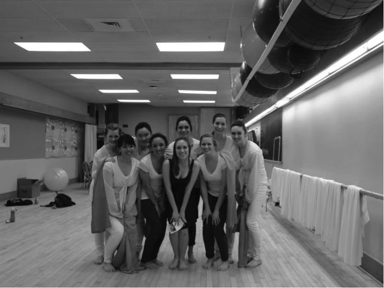 "Armida Portman '14 poses with dancers from her recital ""The Flow of the River."""