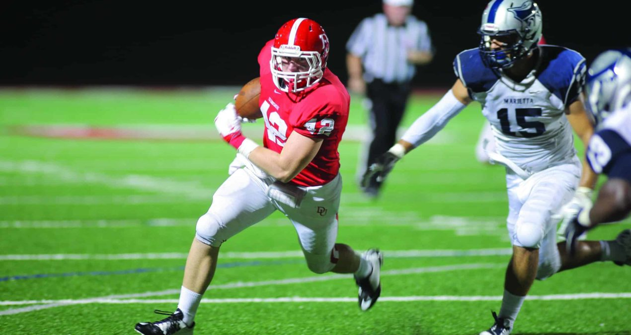 Football sends Hiram to the dog house in 33-19 comeback victory