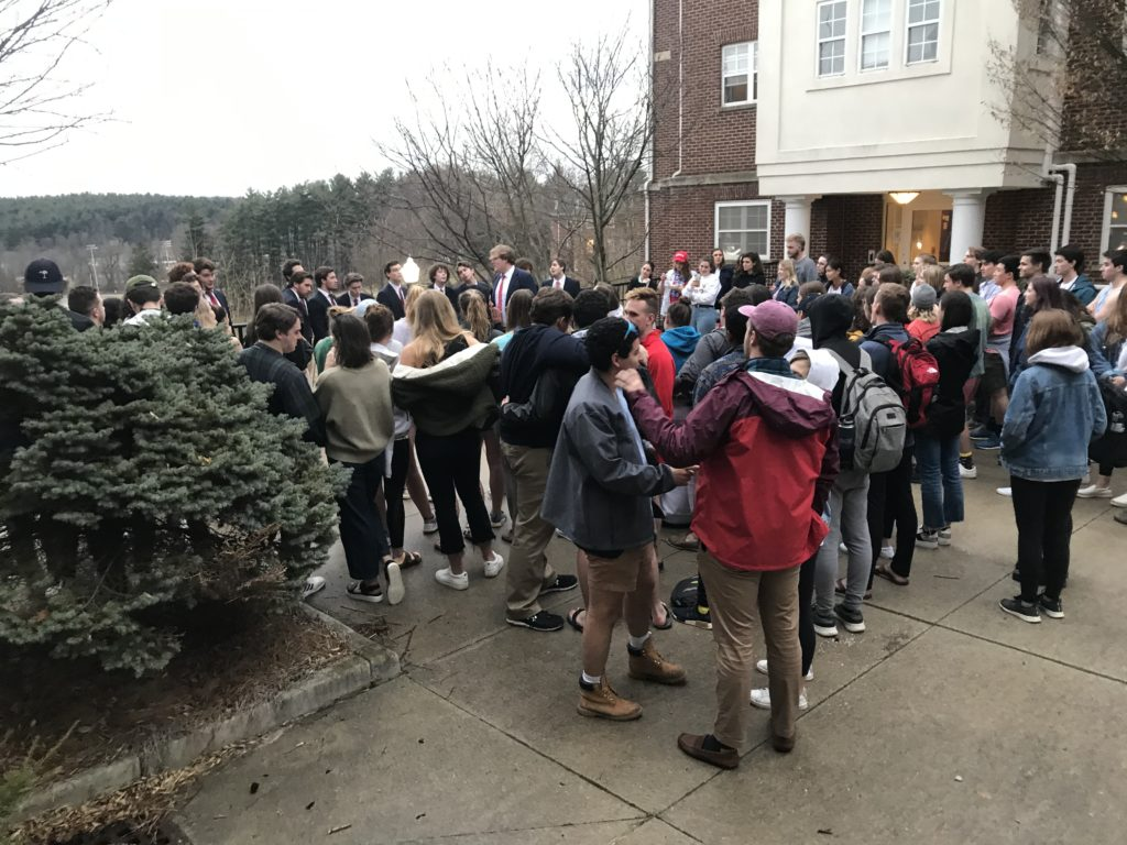 Students gather around the Hilltoppers for a concert between the senior apartments, the Brownstones.